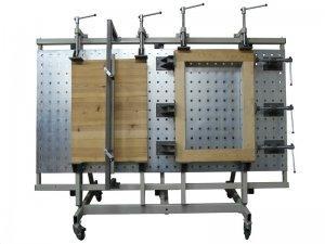 Ściski śrubowe przesuwne Typ SRW-1 na stojaku z płytą otworową Typ SPO 2