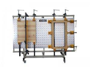 Ściski śrubowe przesuwne Typ SRW-1 na stojaku z płytą otworową Typ SPO 1